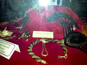 Tortoise shell large hair combs. In front and to the left are jewelry made from human hair